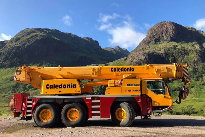 Crane parked up infront of some hills